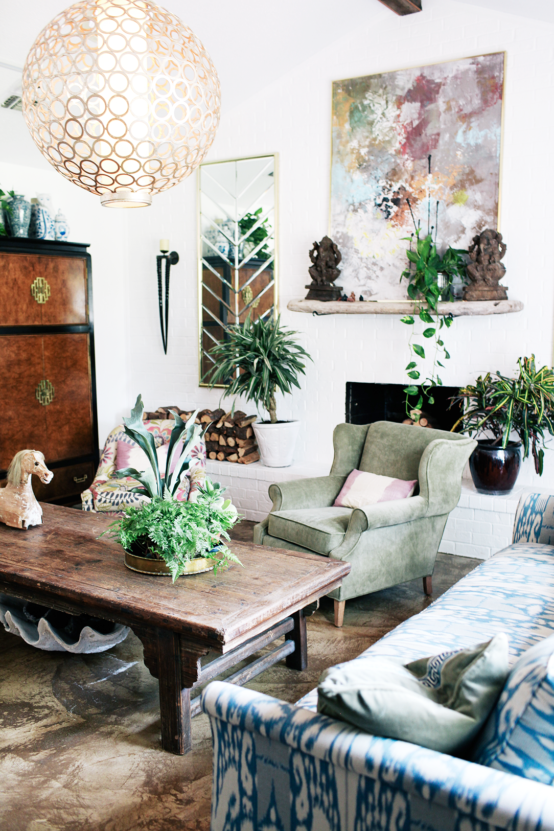 This is a living room that is filled with travelling mementos  Exactly the  inspiration I love for creating my own living space. Judy Aldridge Gives Her Home a Boho Thrift Store Makeover