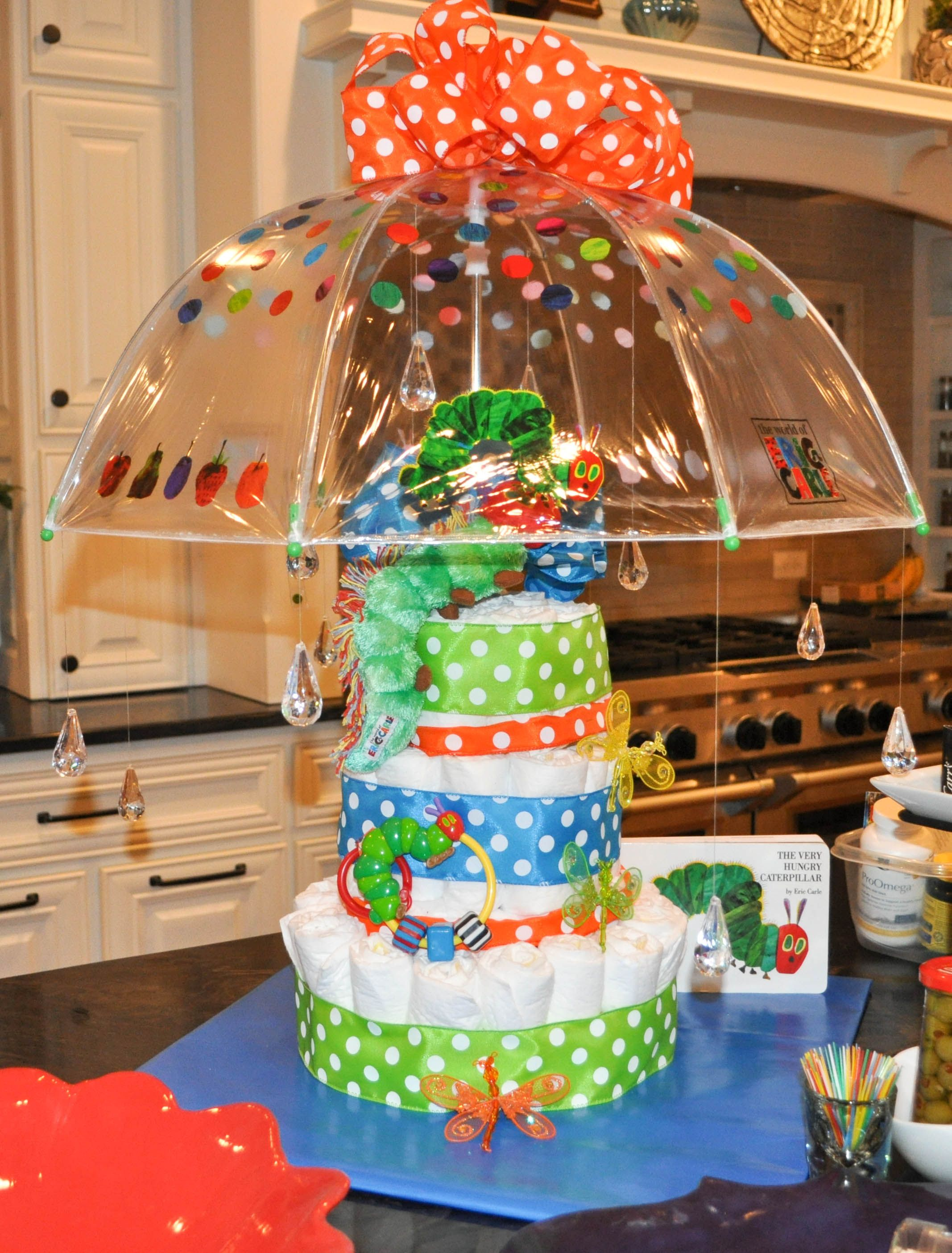 Diaper Cake Using Umbrella And Acrylic Rain Drops For Baby Shower Sprinkle