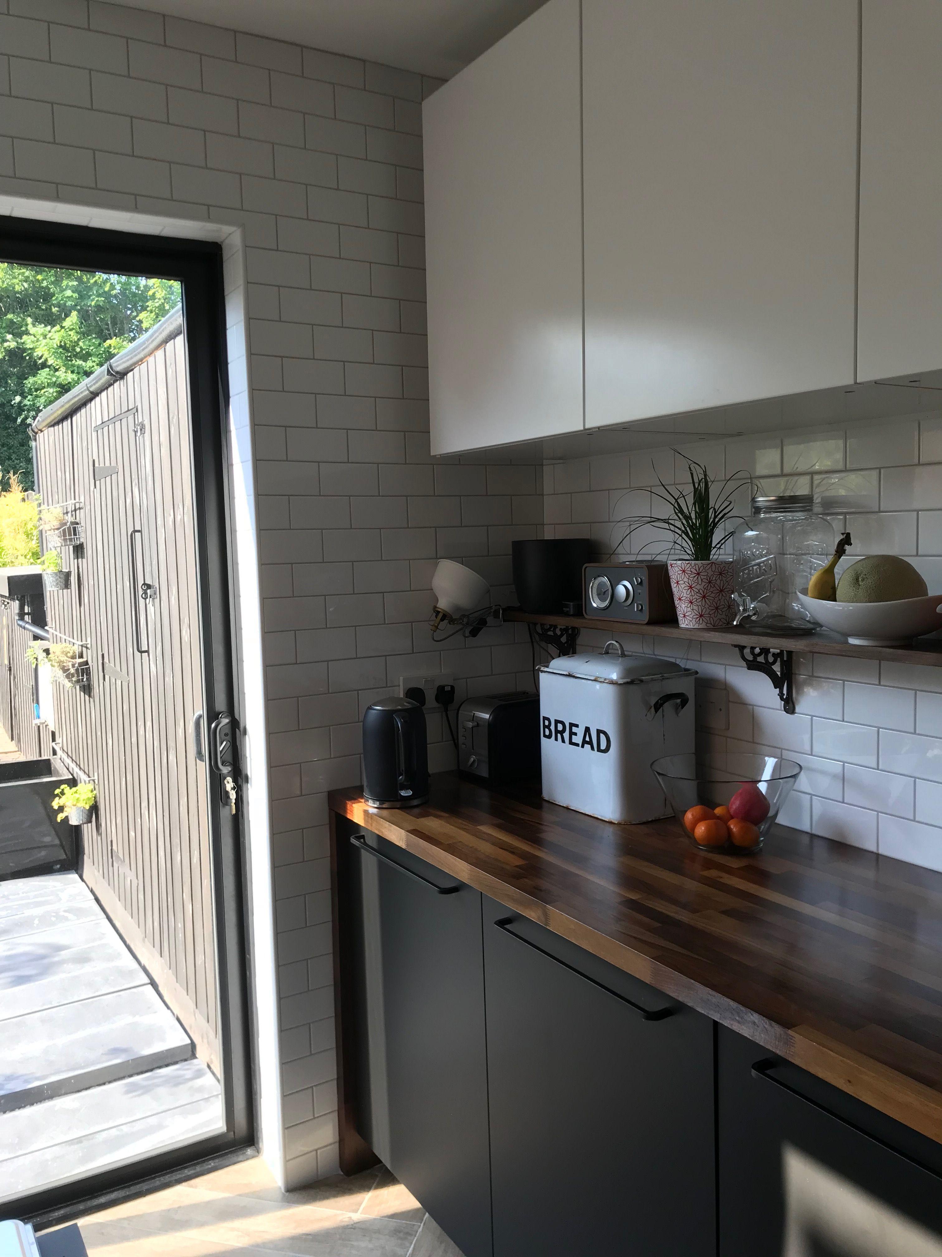 Galley kitchen, sliding patio doors, metro tiles, Ikea