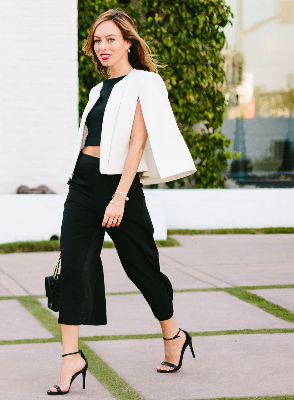 Sydne Style - Los Angeles Fashion writer and People StyleWatch contributor Sydne Summer shows how to wear a white cape over a black crop top and culottes.