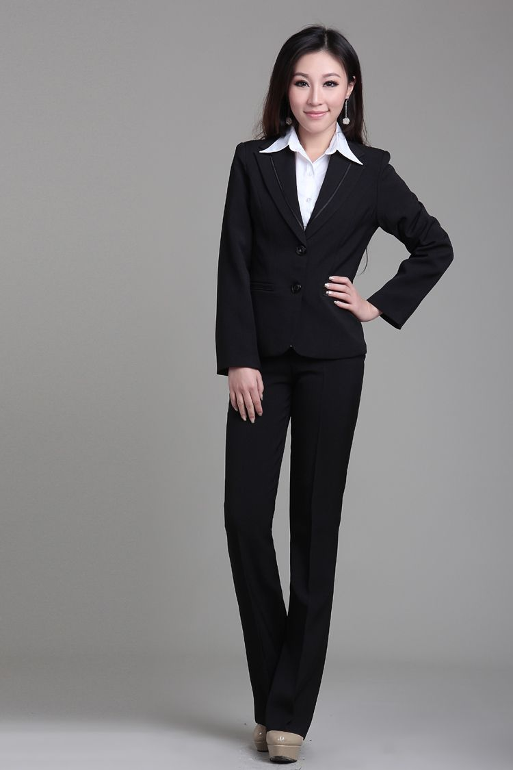 Crisp White Shirt With A Black Suit Worn Beautifully By A Woman With