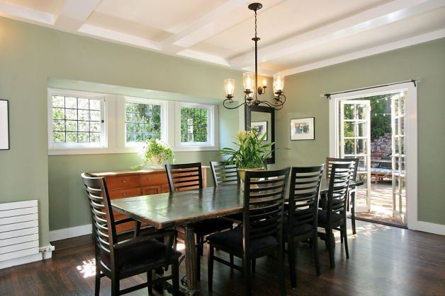 Another Look At The Homes Dining Room With French Doors Leading To Exterior Photo