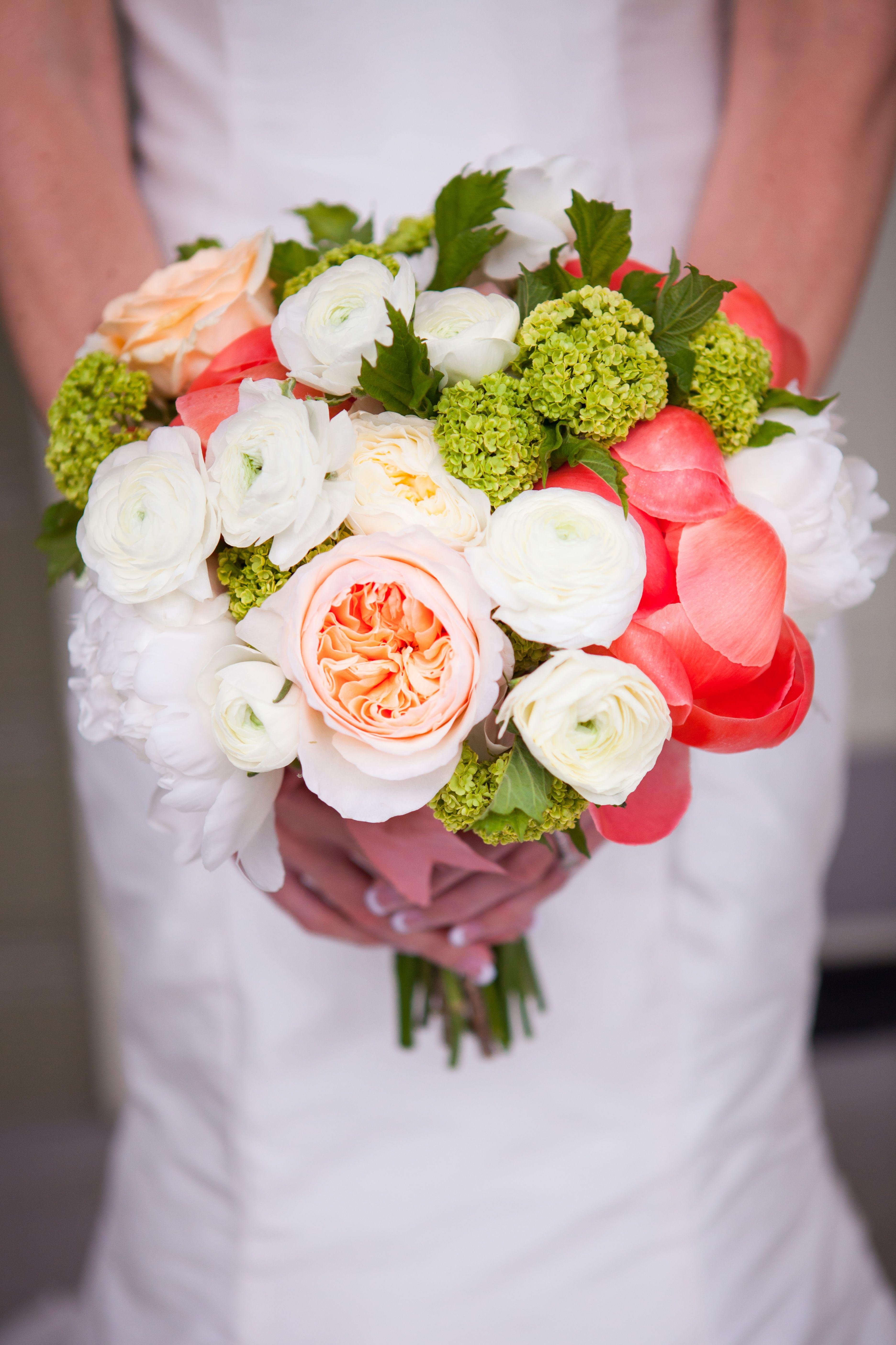 Peony, garden rose, viburnum and ranunculus bridal bouquet in shades ...