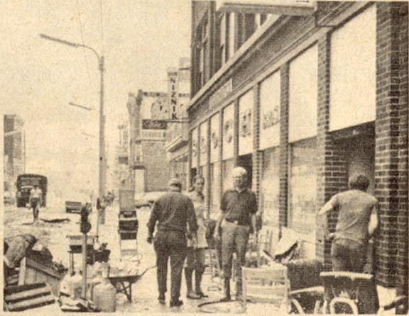 """South Main Street, Wilkes Barre.  """"Operation Snapback.""""   Clean-up after Hurricane Agnes (1972).   Kingston and Wilkes-Barre, PA."""