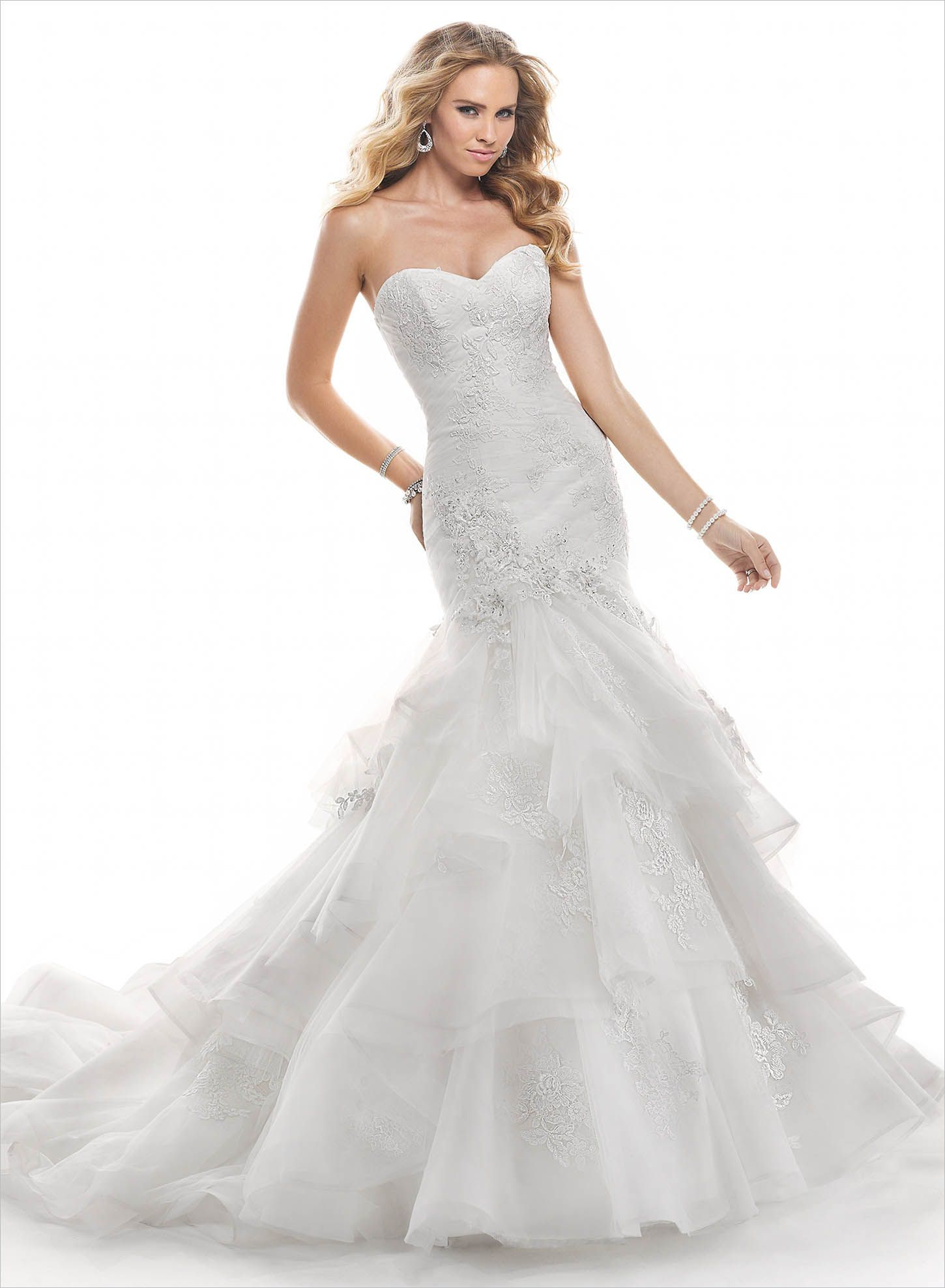 e7e98b195c05b4 ... is this corded embroidered and Chantilly lace on tulle over Chic Organza  gown, with a form fitting ruched bodice and cascading layered skirt.