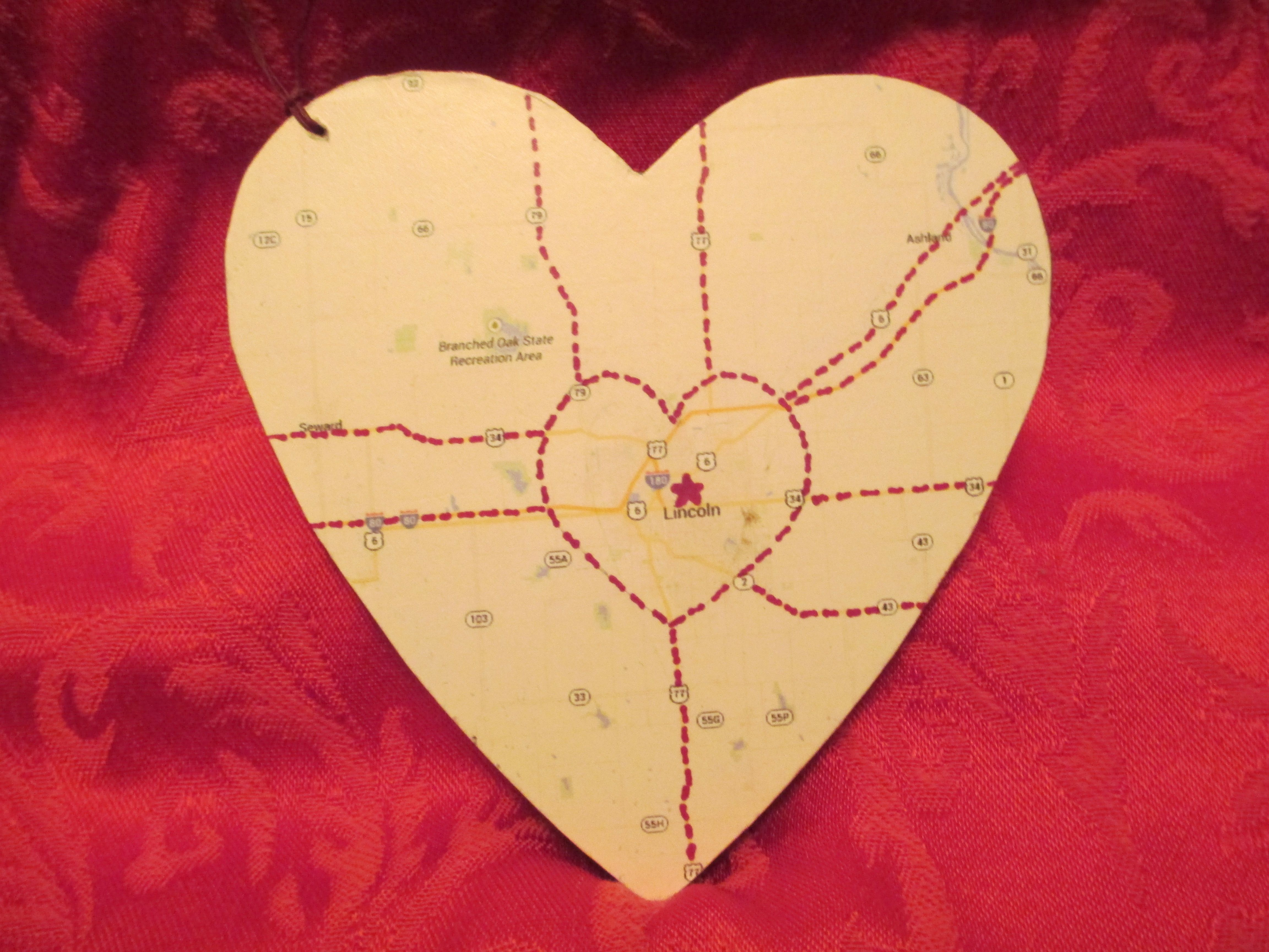All roads lead to Lincoln.... on wooden heart