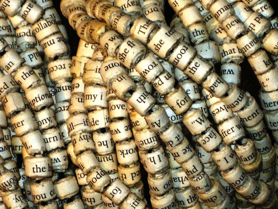 Word beads, just follow basic directions for paper beads using old book pages.  Words by Helen Lonsdale, via 500px