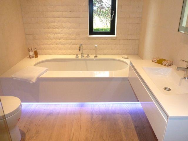 Modina Inset Oval bath set into a White Composite bath surround ...