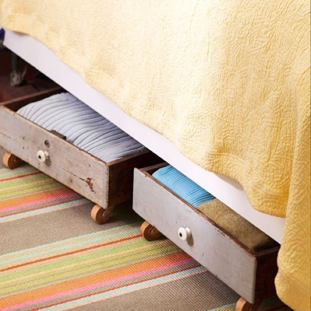 Old drawers + rollers = easily accessible under bed storage!!