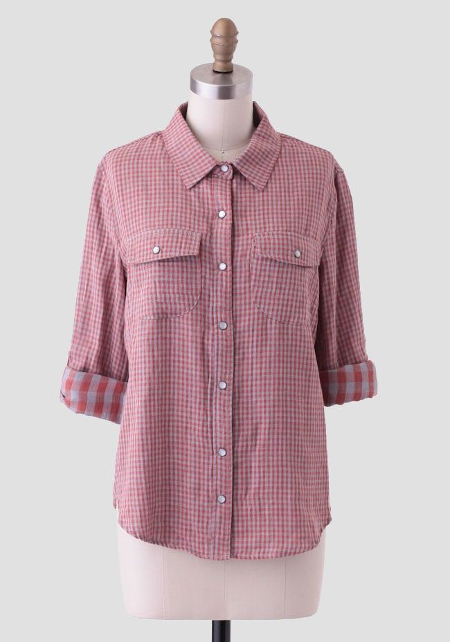 Rendered in soft cotton, this rust-orange and gray-hued top is adorned with a rustic gingham print, front flap pockets, and faux mother-of-pearl button closures down the front. Perfected with a r...