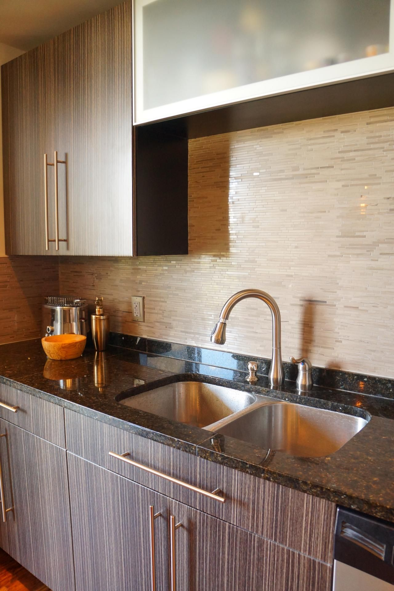 ultra thin mosaic tiles run horizontally along this kitchen s backsplash creating subtle on kitchen interior tiles id=44389