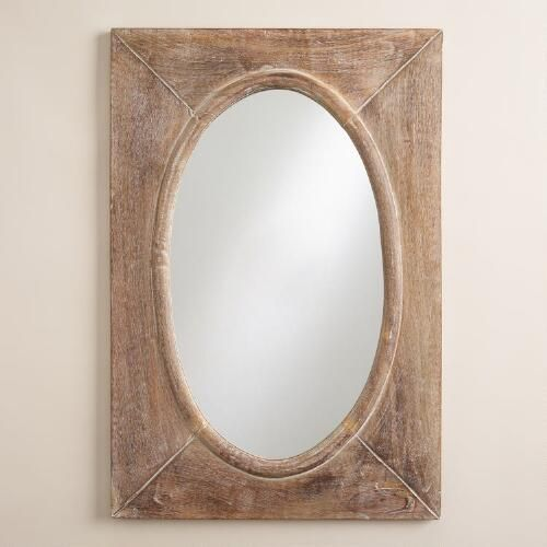 Pic Of Our handcrafted mirror features an oval mirror laid in a rectangular wood profile with a burnished