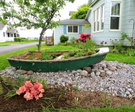 Old boat used as planter for Yard planter ideas