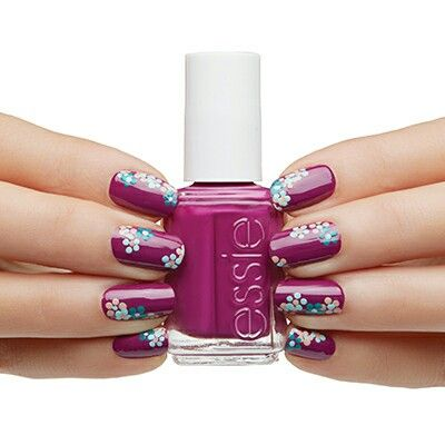Red purple fingernail polish with flowers nail art by essie