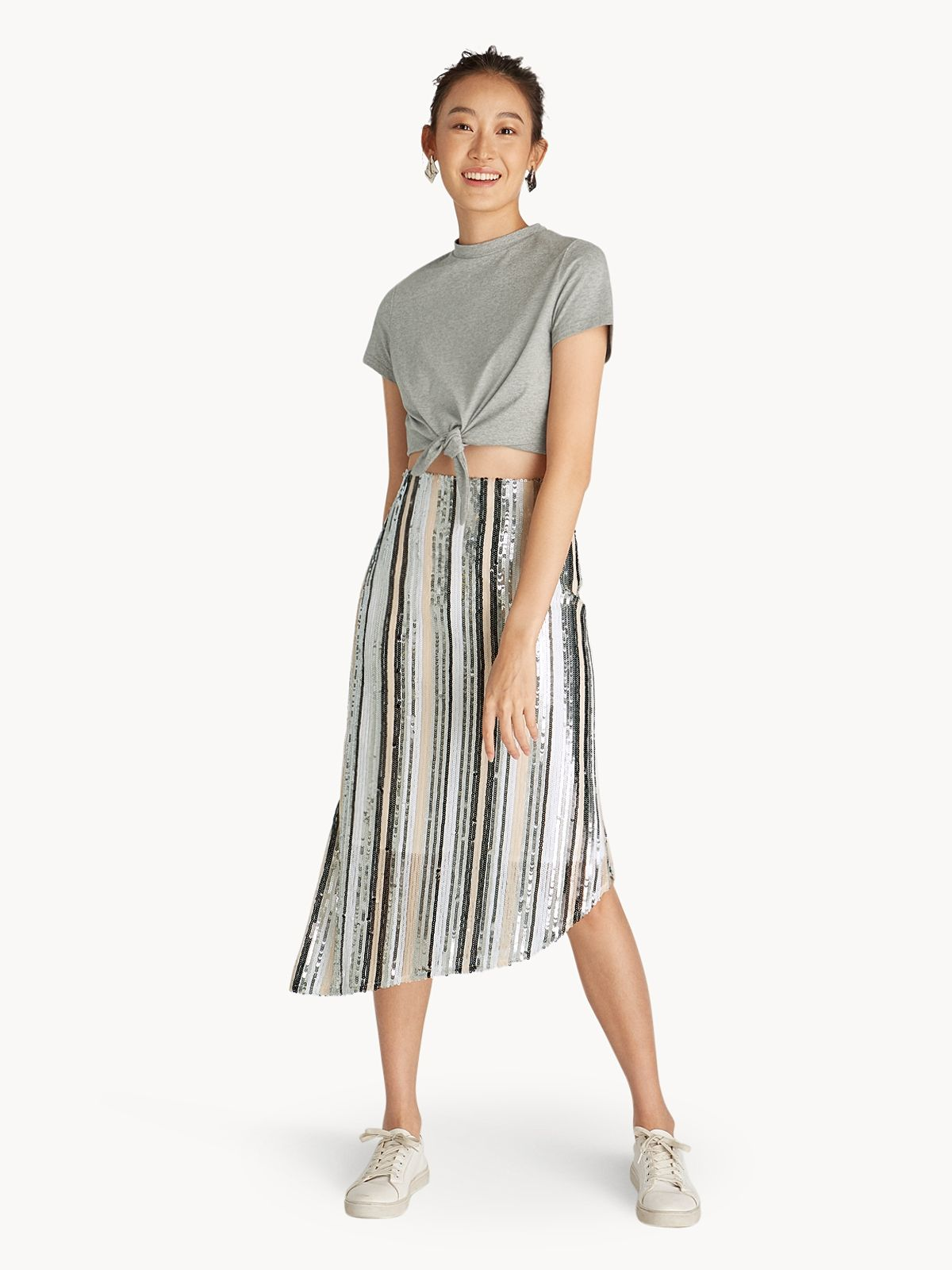 a02f508afe Sequins Polyester Classic, regular fit Features an asymmetrical hemline  design Includes an invisible back zip