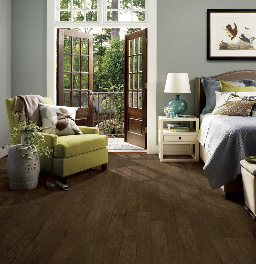 Light grey walls with dark wood floor in bedroom with for Bedroom ideas dark wood floor