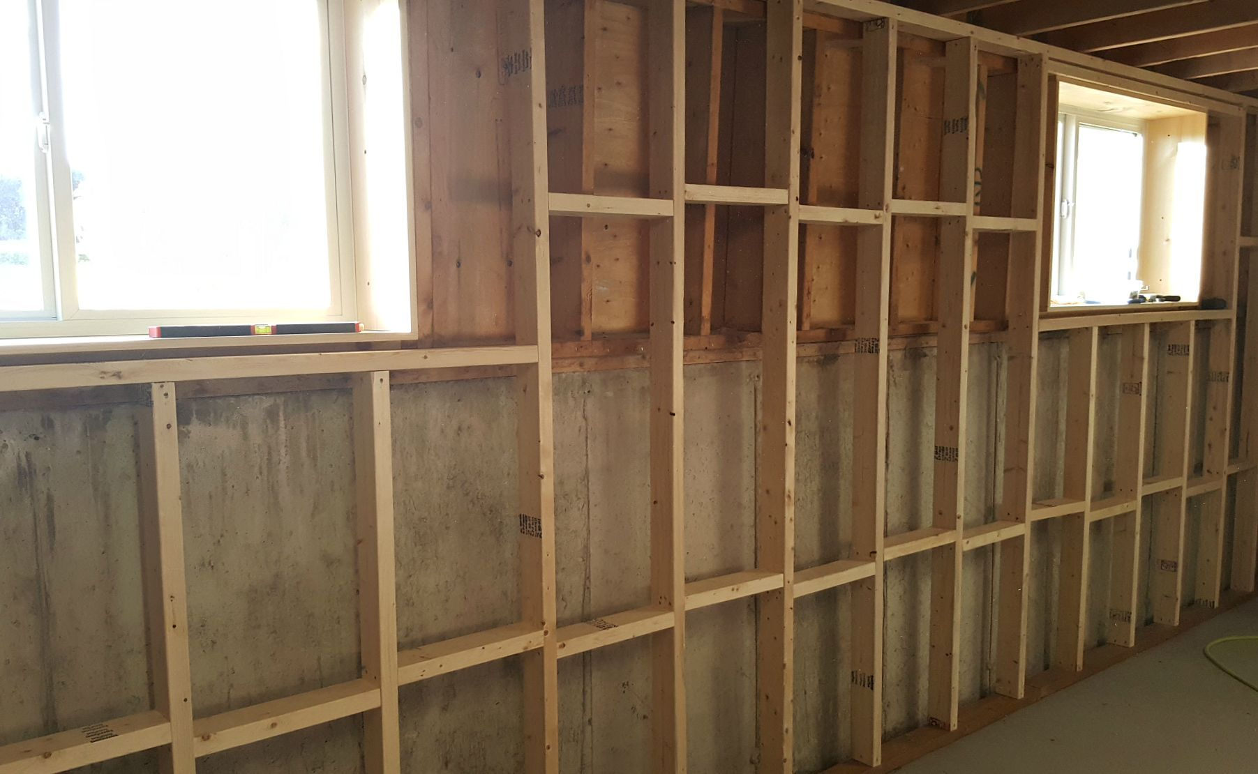 Basement Framing And Spray Foam Insulation Framing Basement Walls Basement Remodel Diy Basement Remodeling