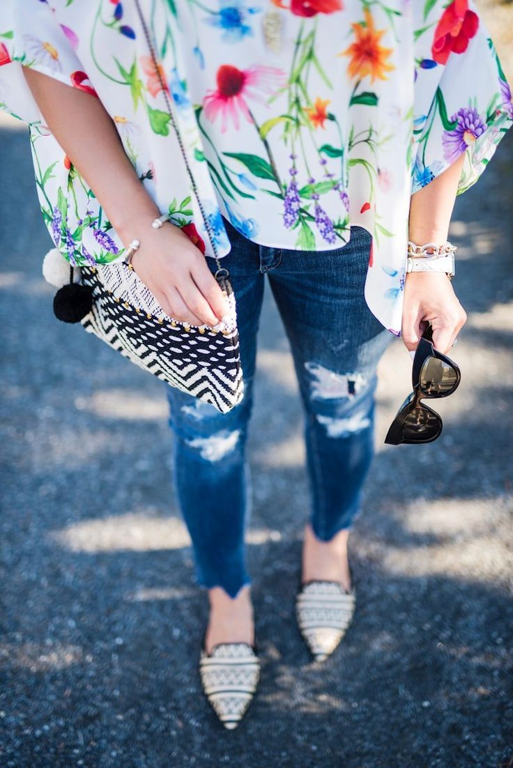floral pattern play, floral top, bright colored floral top, ribbed denim jeans, black and white clutch, geometric clutch, black and white mules, patterned mules, spring fashion, spring outfit ideas, spring outfit inspo, floral tank top, colorful shirt, colorful top, heres the skinny blog