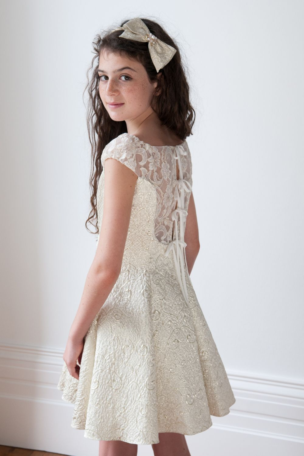 This is our ivory and gold girls bridesmaid dress the perfect