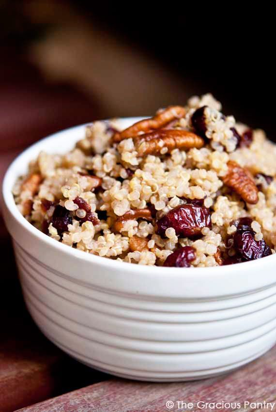 cups cooked quinoa, cooked with unsweetened almond milk, cooled* 1 cup juice sweetened, dried cranberries 1 cup pecan pieces 1/2 tsp. cinnamon 2 tbsp. honey 4 tbsp. fresh lemon juice