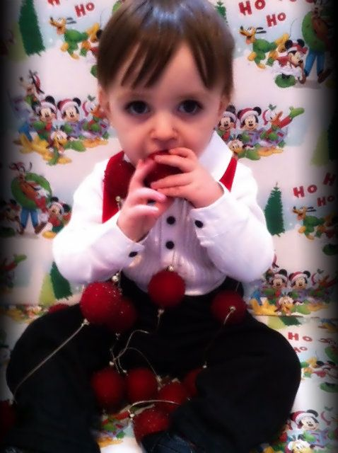 homemade xmas photos- wrapping paper taped on the wall for background