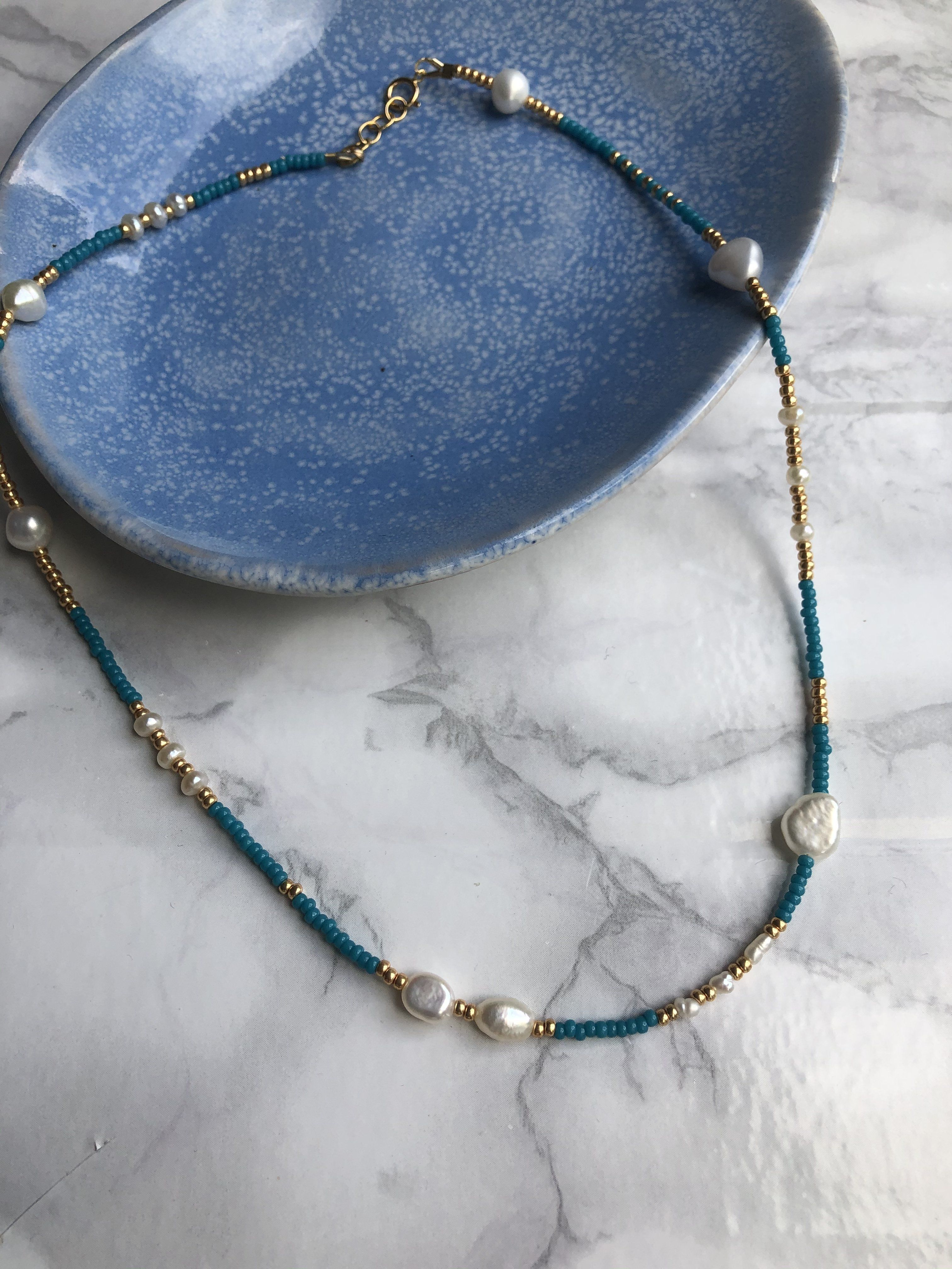 Photo of Santorini Freshwater pearls teamed with brightly coloured seed beaded necklace. – Teal