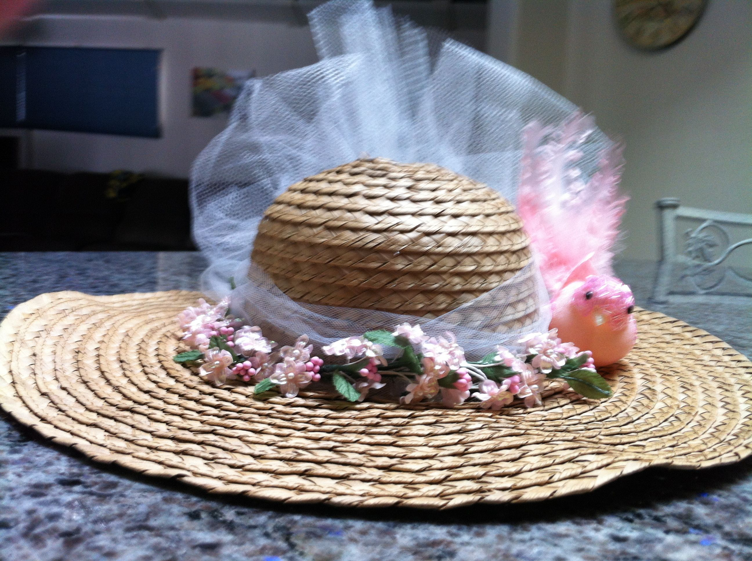 Decorating Easter Bonnets Tied Tulle In A Bow And Glued Upward For The Lift In The Back Easter Bonnet Crafts Spring Gifts