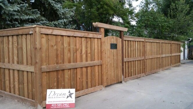 Brown Pressure Treated Ultra Fortress Style Fence With Overlapped Boards Fence Design Wood Fence Design Backyard Fences