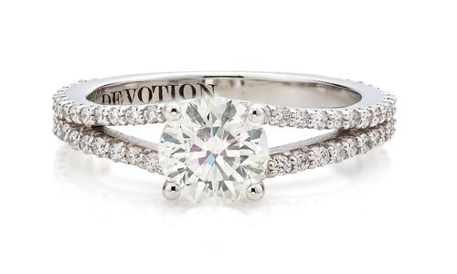 This Split Diamond Encrusted Band Accentuates A Beautiful Round Brilliant Devotion Center Stone Clic With Twist Paired Dual Insert Wedding Bands
