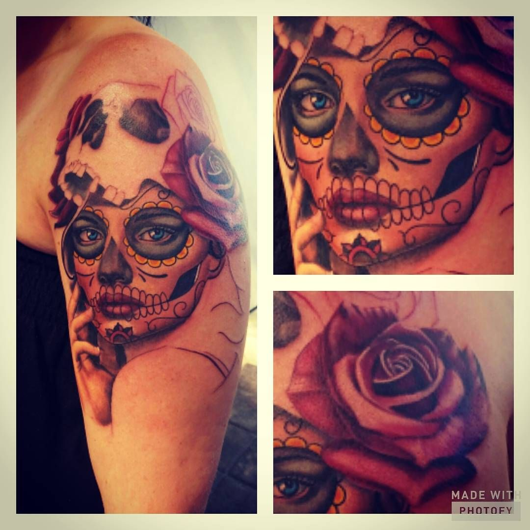 Sugar skull tattoo on woman's shoulder with rose and ...