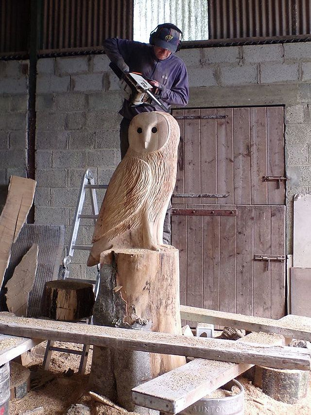 Chainsaw carved owls in a variety of styles wood