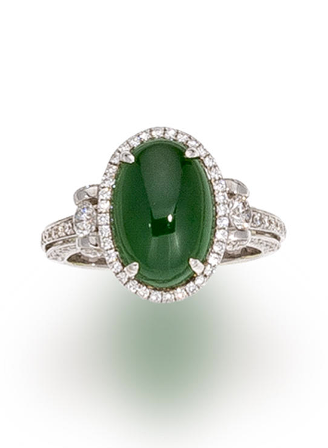 d961c3949902d A jadeite jade and diamond ring centering an oval cabochon jadeite ...