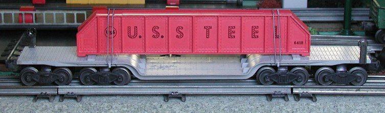 Lionel postwar # 6418 Machinery flatcar with pinkish-orange U.S. Steel girders.