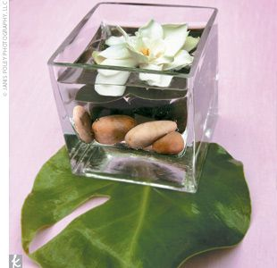 Other Centerpieces Included Short Square Glass Vases Filled With River  Rocks And Lotus Flowers. Part 85