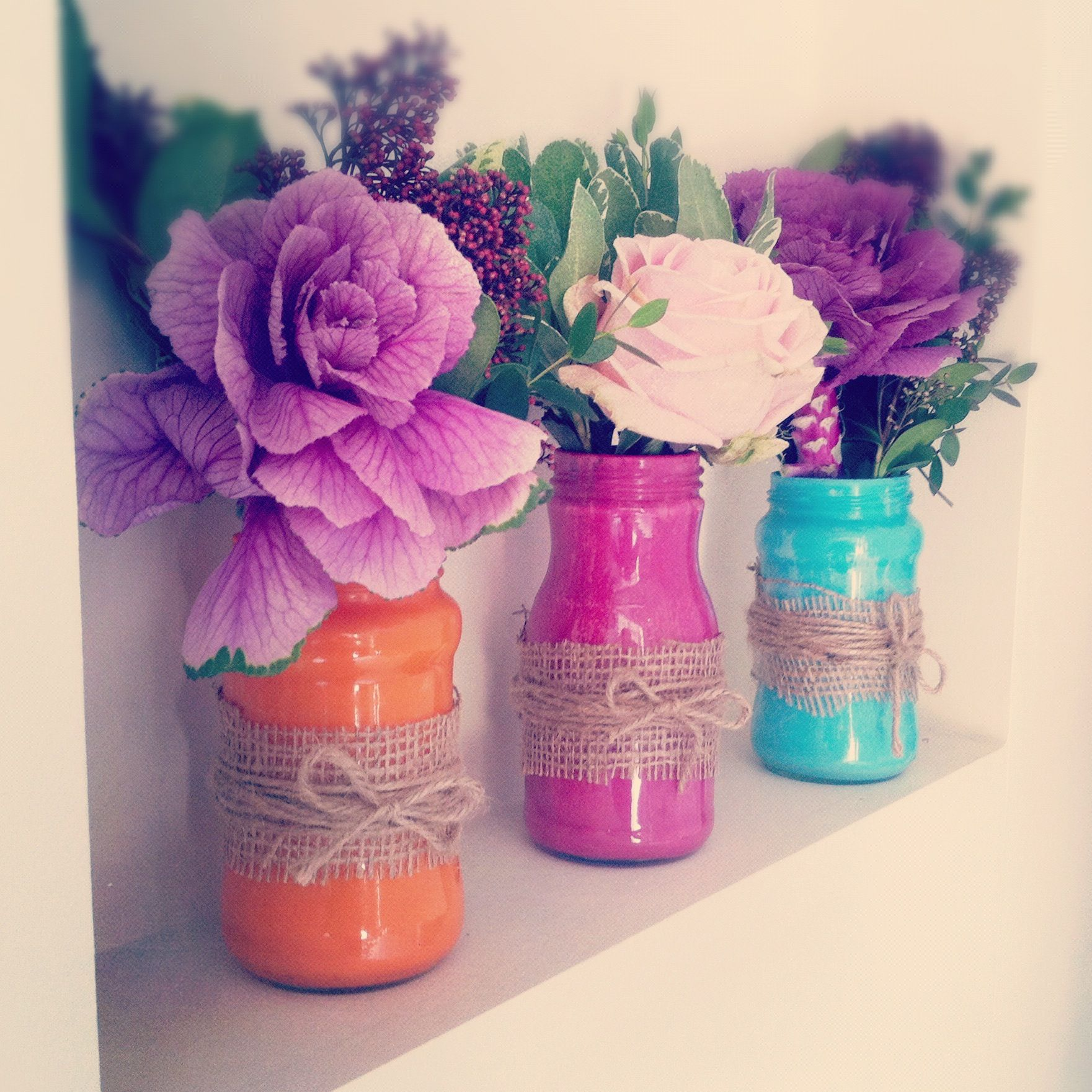 inside painted jam jars. I love these as an idea for centre pieces ...