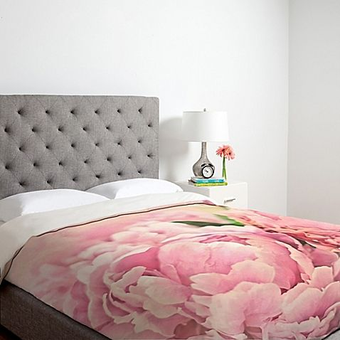 The Lisa Argyropoulos Pink Peonies Duvet Cover blooms with cheerful colors in beautiful shades of pink. The artistic bedding bursts with natural peony images that look stunningly feminine and delicate. A solid cream back finishes this lightweight duvet.
