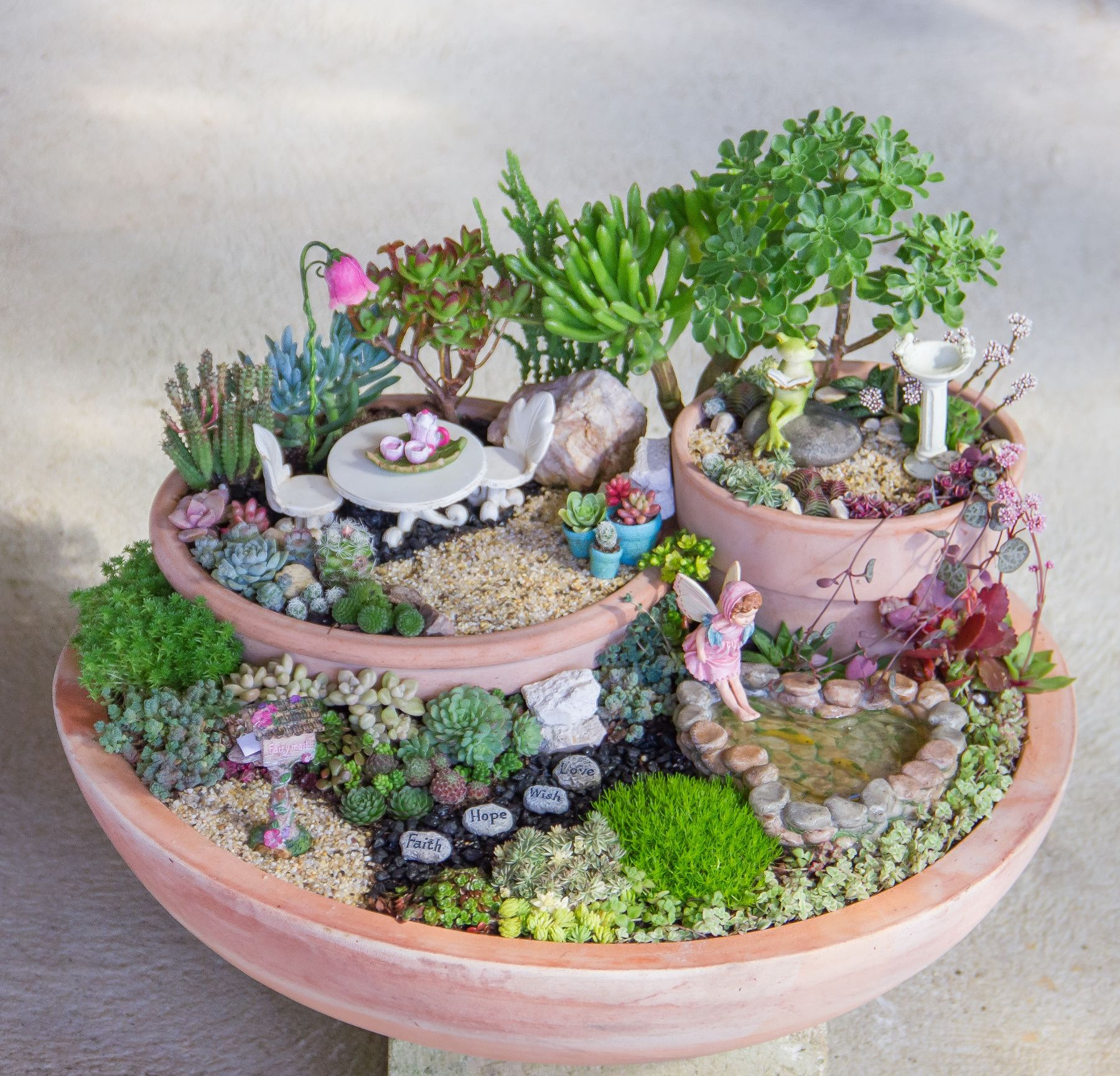 This Spring Leave Room In Your Garden For The Fairies To Dance Rotomolded Planters Are The P Succulent Garden Diy Fairy Garden Flowers Indoor Fairy Gardens