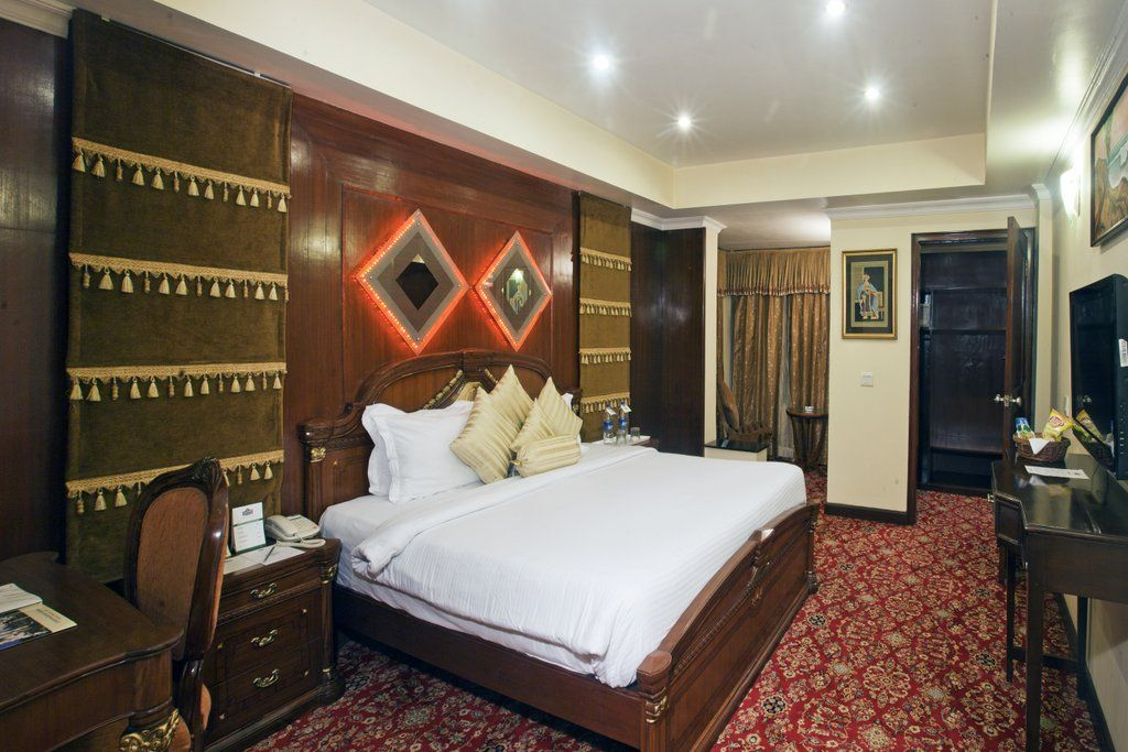 Presidential Suite Bed Room -- Country Inn & Suites By Carlson, Haridwar is epitome of comfort and luxury, with a soft touch of royalty to make you feel special without being too heavy on your pockets.
