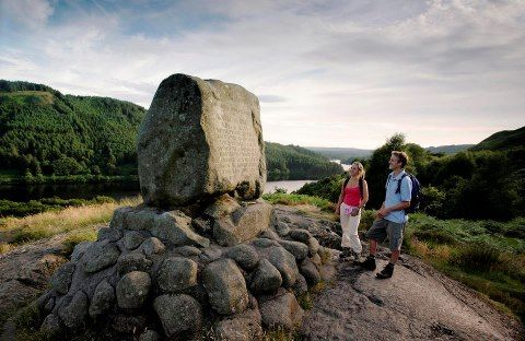 Bruce's Stone - a granite boulder on Moss Rapploch which commemorates Robert the Bruce's first victory over an English army in 1307. Views of Loch Trool and the Galloway Hills are in the background.