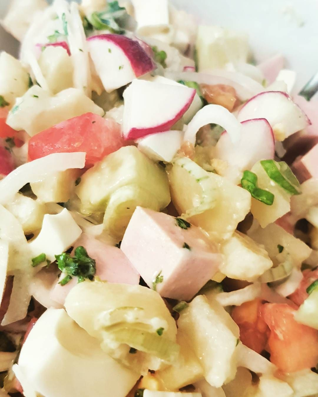 Love the russian kitchen  Okroschka - this is a typical russian summer salad/soup  Well yes as a recipe varies from home to the next home- this is what i put in there. Tomato and green onion Potatoes !!!   Cucumber and radishes Sausage some parsley eggs and for the dressing or better called