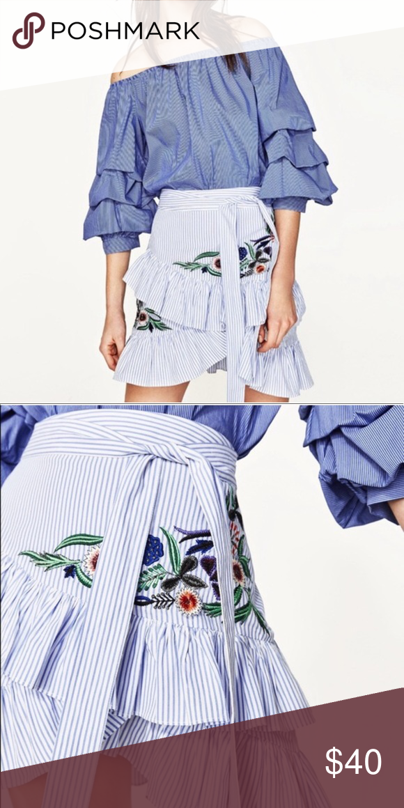 15737ad2ad ZARA Striped Wrap Ruffle Skirt White and blue pinstriped wrap mini skirt  with ruffled trim. Zip side closure. Self belt. Embroidered floral detail.