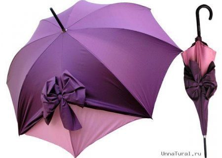 Purple, girly but simple umbrella. Reminds me of Binky. Purple is her favorite, she's an understated girly-girl and she hates to get wet in the rain.
