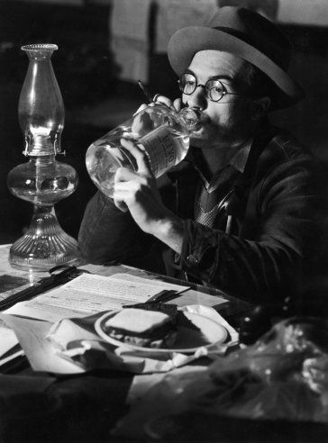 """February 15, 1937, : """"Boiled water was the only safe water for drinking in the flooded city. Editor Wilbur Cogshall of the Louisville Courier-Journal slept, ate and drank at his desk."""""""