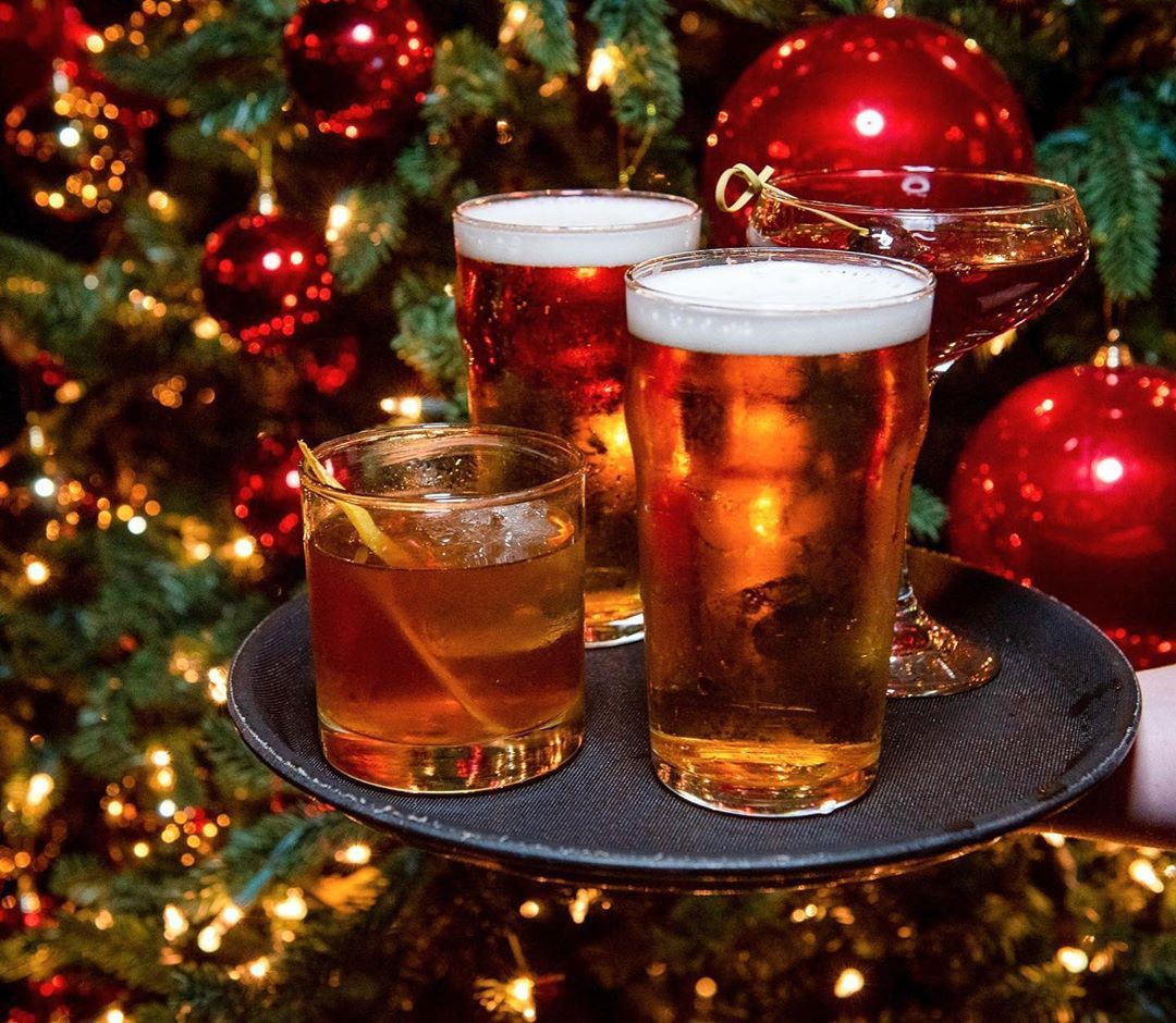 In here, we're serving up holiday cheer! Stop by for happy hour and revel in our... #beer #celebrate #celebration #cheers #christmas #christmasinnyc #christmaslights