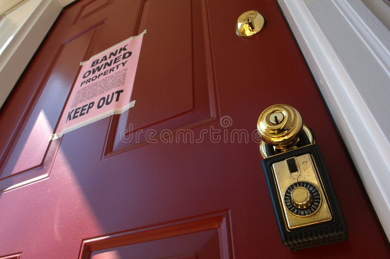 Real Estate Bank Foreclosure Notice on House Door Real estate lock box and bank