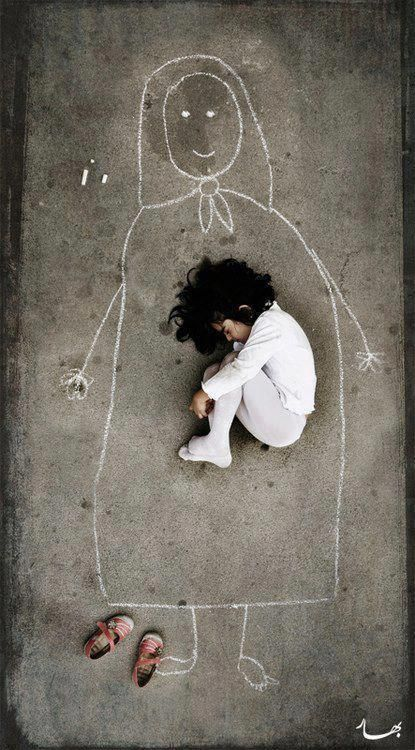 A little girl in an orphanage draws a picture of her mother on the floor and slept on her arms.
