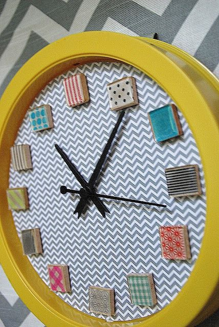 Washi tape clock tutorial.  (I can see this done with scrapbook papers that coordinate along with glass tiles instead of scrabble tiles)  OR how about a picture of something or someone you love at each number!