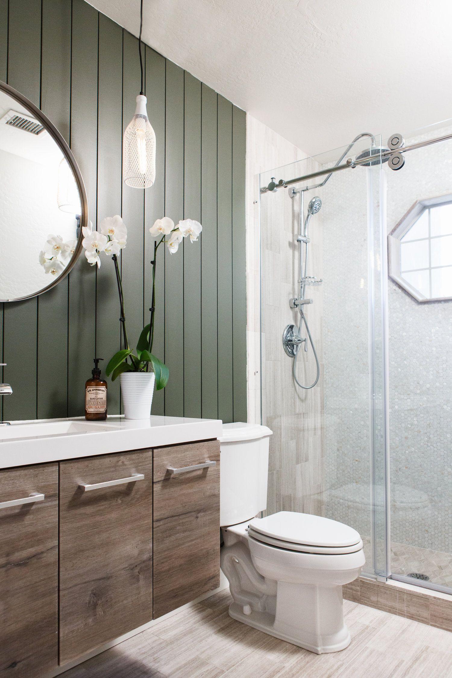 dark green shiplap, reclaimed wood vanity and limestone tile create ...