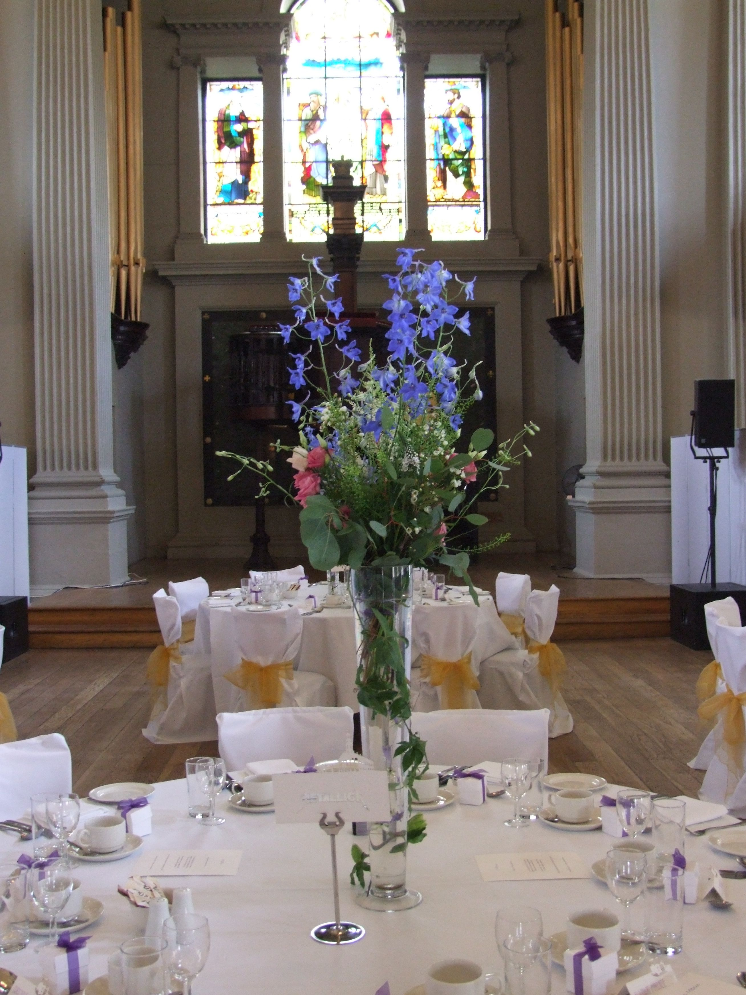 Colourful Table Centres With Bright Blue Delphiniums