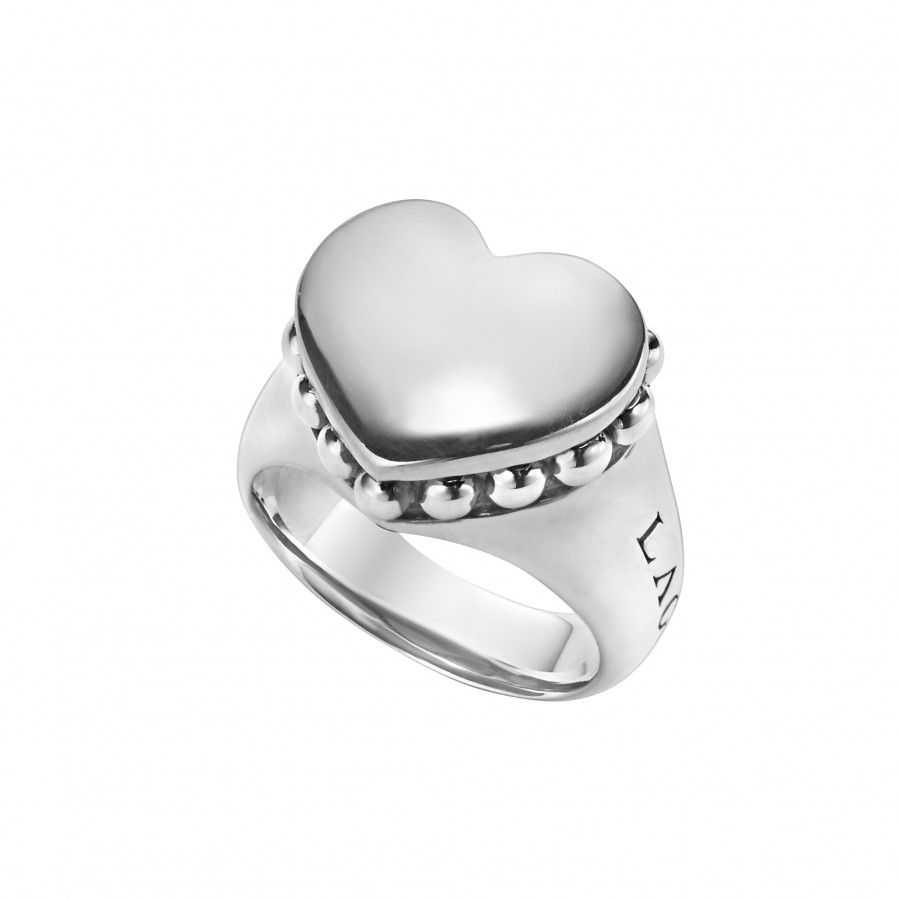 Highly polished sterling silver heart ring with a frame of Caviar ...